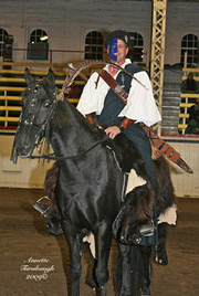NAC 2010 - An image of a man dressed in Celtic fashion, Sporting facepaint, a Kilt and a Claymore, Atop a black horse.