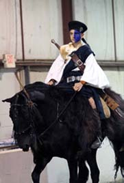 NAC 2011 - An image of a rider sporting a highlander outfit while on a black horse.